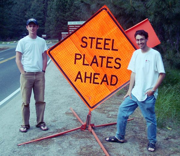 Matt and Caleb in front of Steel Plates Ahead sign in Yosemite National Park